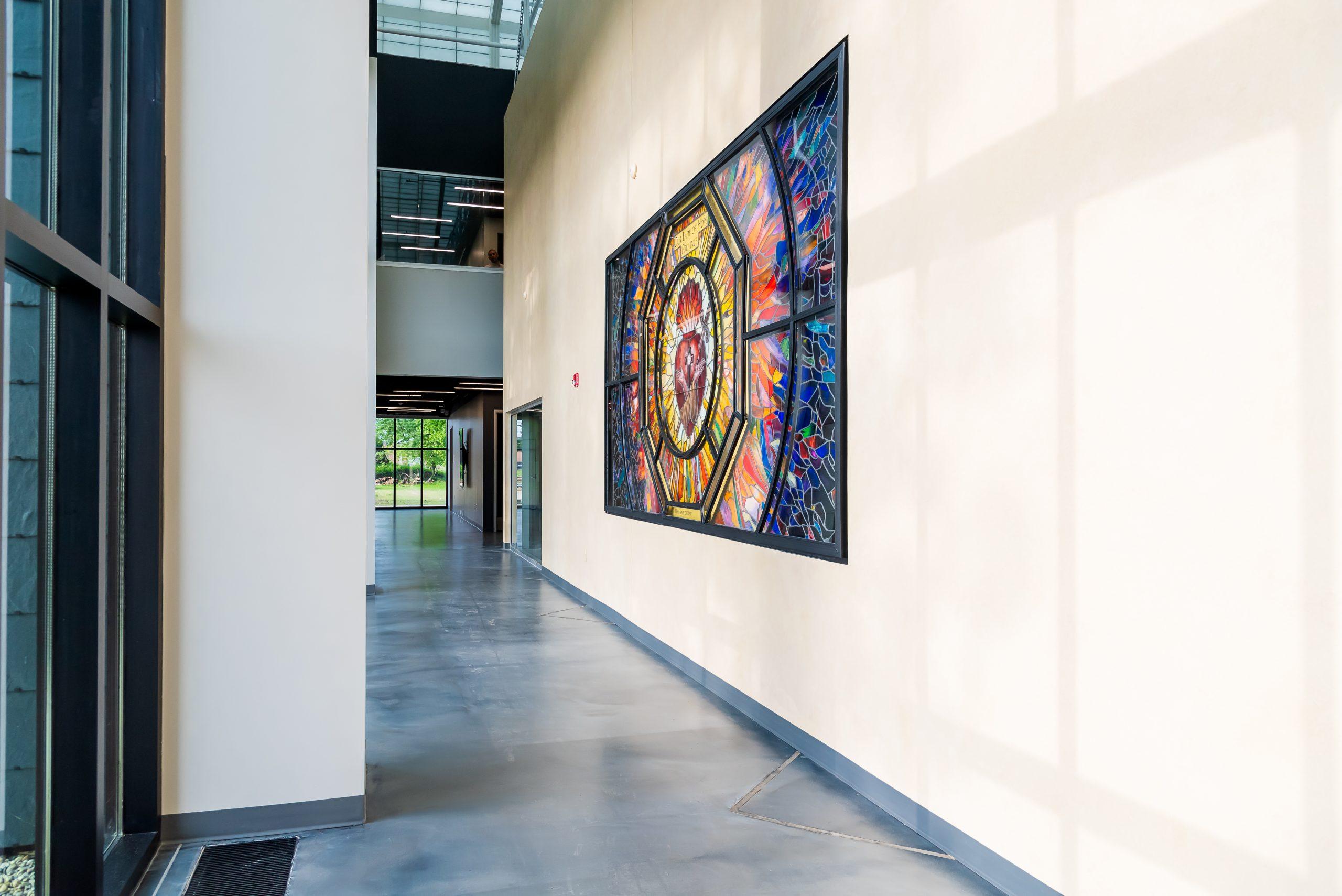 Hallway with stained glass window